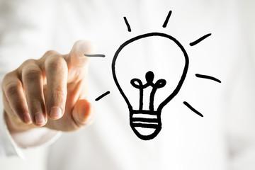 Man with a bright idea - a light bulb