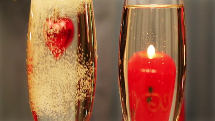 valentines day - heart and candle in glasses with champagne