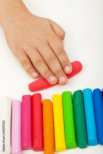 Child hand with modeling clay