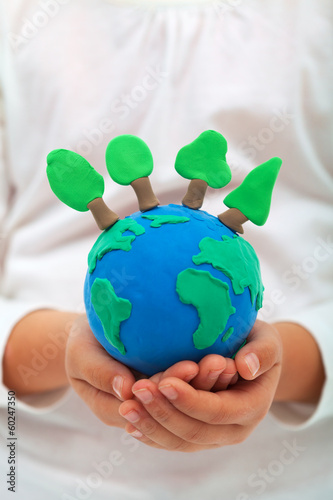 Ecology and environment concept with trees on clay world