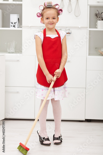 Little girl doing housekeeping work