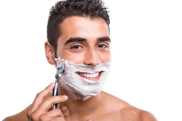 Man shaving his face