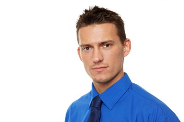 Portrait of young businessman in blue shirt