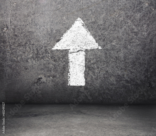 Concrete room with arrow on the wall