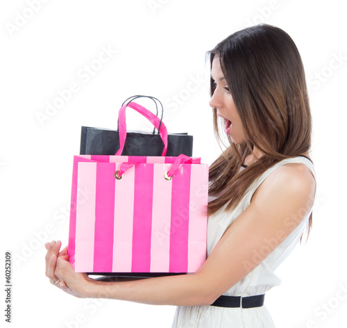 Pretty young woman with shopping bags after clearance sale