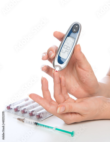 measuring glucose level blood test with glucometer