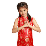 Smiling little asian girl with cheongsam respecting on chinese n