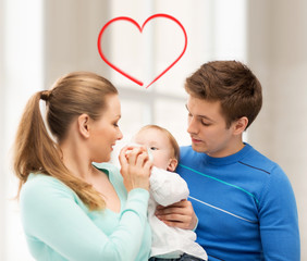 family and adorable baby with feeding-bottle