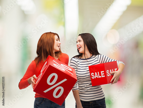smiling teenage girl with percent and sale sign