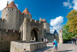 Porte Narbonnaise and turists at Carcassonne