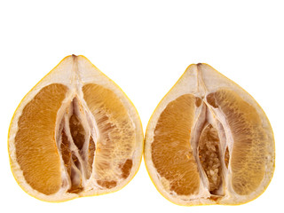 Two halves of pomelo isolated on white background