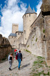 Tourists walkig in the walls of Carcassonne medieval city