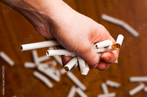 hands breaking a cigarette