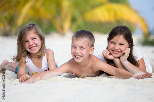 Happy children enjoy summer day at the beach