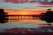 Sunrise at a marina pier with reflection - 60254509