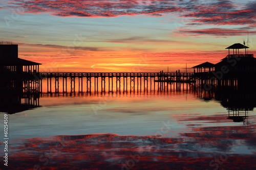 obraz lub plakat Sunrise at a marina pier with reflection