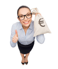 happy businesswoman holding money bag with euro