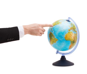 businessman pointing finger to earth globe