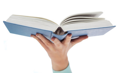 close up of woman hand holding open book