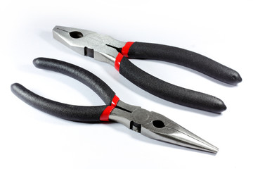 Two pliers on white background