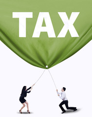 Business team pulling tax banner