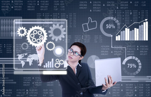 Business woman works with business interface