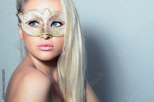 Beautiful Blond Woman in Carnival Mask.Masquerade.Sexy Girl
