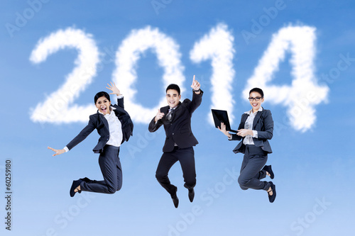 Excited businesspeople jumping on the sky