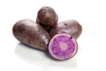 violet potatoes isolated on white background - vitelotte -