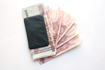 1000 and 100 baht banknotes and calculator