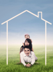 Happy family with home drawing