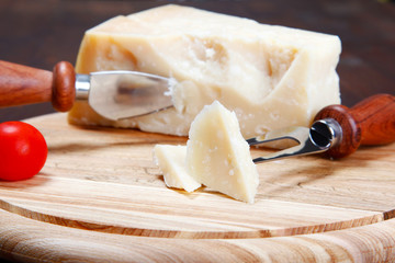 italian parmesan cheese on a cutting board