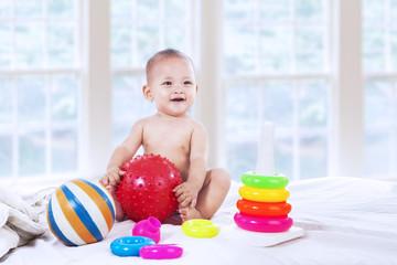 Little baby holding ball