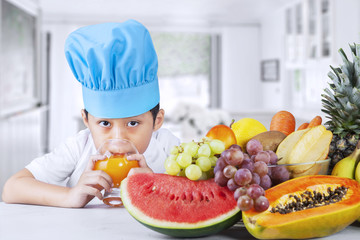 Little boy with fresh fruits