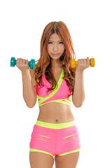 Attractive Asian woman lifting dumbells