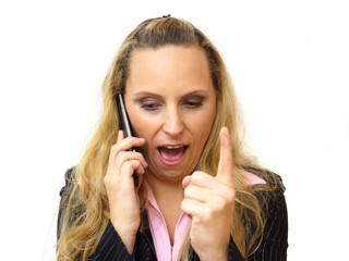 Angry business woman screaming in her cell phone