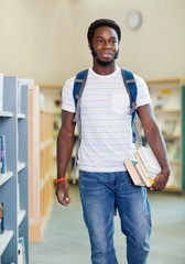 Student With Books Looking Away In Library