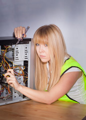 female technician repairing computer
