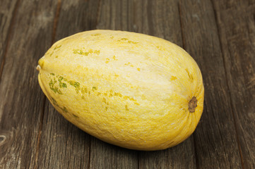 Big marrow squash on wooden background.