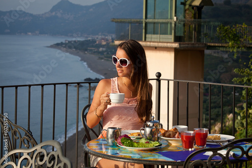 Beautiful woman with breakfast
