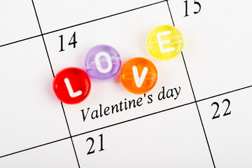 Calendar page with the red hearts on February 14 of  Valentines