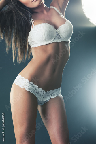 Body of a sexy brunette in white lingerie