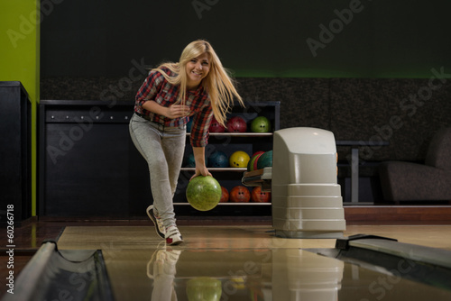 Young Women Bowling