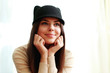Young beautiful happy woman in cute hat looking away
