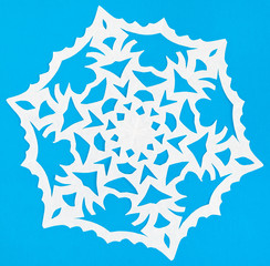 white snowflake on blue paper