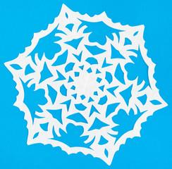 white snowflake on blue paper