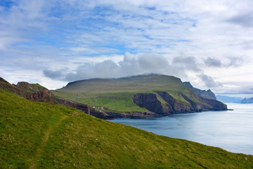 Majestic landscape of Mykines, Faroe Islands : green and blue
