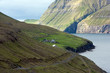 Fjord surrounded by green mountains