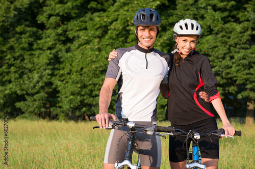 Young Sportive Couple On Bicycle
