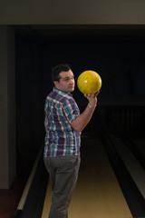 Man Holding A Bowling Ball
